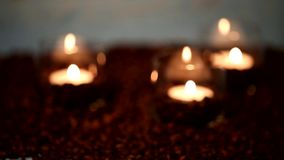 Burning candle surrounded by coffee beans stock video footage