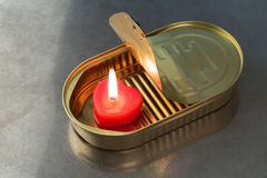 Burning candle in a tin Stock Images