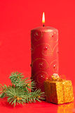 Burning candle and tiny present box Stock Image