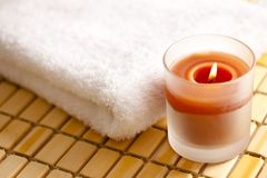 Burning candle and towel Stock Photography