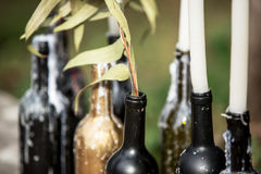 Burning candle in the vintage black bottle. Wedding decor Royalty Free Stock Photography