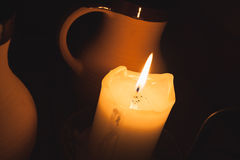 Burning candle and vintage clay cups of beer Royalty Free Stock Photography