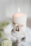 Burning candle with wedding rings Royalty Free Stock Photos
