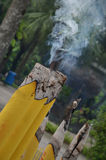 Burning Candle. Yellow candle with smoke coming out of the candle. Taken in Hong Kong near the Big Buddha royalty free stock images