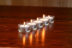 Burning candles. On the dark wooden surface Stock Photography