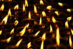 Burning candles. Background of burning candles receding into distance Stock Images