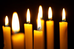 Burning candles. Romantic burning candles on black background Royalty Free Stock Photo
