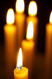 Burning candles. Romantic burning candles on black background Stock Images