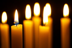 Burning candles. Romantic burning candles on black background Royalty Free Stock Photography