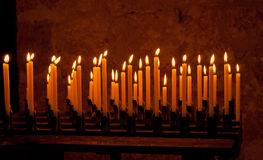 Burning candles. Row of burning candles in a church stock image