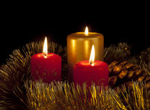 Burning candles. Free Burning candles in cristmas decoration royalty free stock images