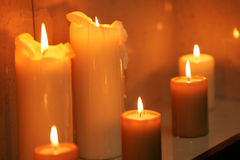 Burning Candles. A portrait of six burning Candles, seen here stood on a table Stock Photography