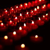 Burning candles. In catholic church Royalty Free Stock Photo