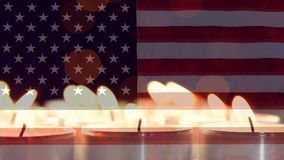 Candles Video. Burning Candles against american flag background stock video