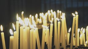 Burning candles. On altar in church stock footage