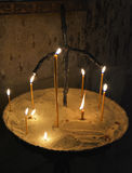 the burning candles in ancient church Royalty Free Stock Images