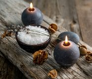 Burning Candles And Sea Salt On Wooden Background. Royalty Free Stock Photography