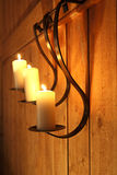 Burning candles as wall decoration Stock Image