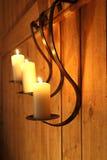 Burning candles as wall decoration. Three burning candles as wall decoration Stock Image