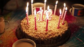 Burning candles on a birthday cake