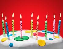 Burning candles on a birthday cake Royalty Free Stock Photography