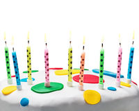 Burning candles on a birthday cake Stock Photography