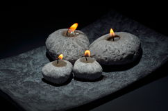 Burning candles  on black Royalty Free Stock Photos