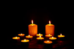 Burning Candles. And black background Royalty Free Stock Photography