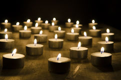 Burning candles. On a black background Royalty Free Stock Image
