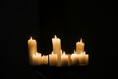 Burning candles on black background Royalty Free Stock Photography