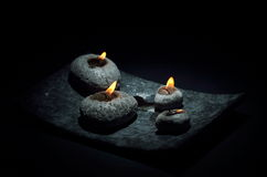 Burning candles  on black Stock Images