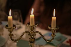 Burning candles. On a blurred background Royalty Free Stock Photos