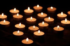 Burning candles with bright flames royalty free stock photography