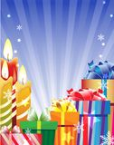 Burning candles and bright gift boxes Stock Image