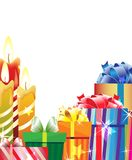 Burning candles and bright gift boxes Royalty Free Stock Photos