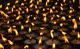 Burning candles at a Buddhist temple stock images