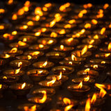 Burning candles in Buddhist temple, India Stock Photo