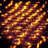 Burning candles in Buddhist temple. McLeod Ganj, Himachal Prades Stock Image
