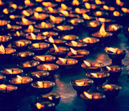 Burning candles in Buddhist temple. McLeod Ganj, Himachal Prades Stock Images