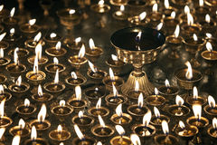Burning candles in Buddhist temple Stock Photography