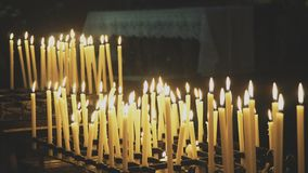 Burning candles. On altar in church stock video footage