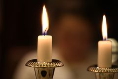 Burning candles. On a blurred background Royalty Free Stock Photography