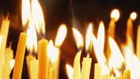 Burning candles. Celebration event or religious memorial attribute of warmth and sincerity stock video