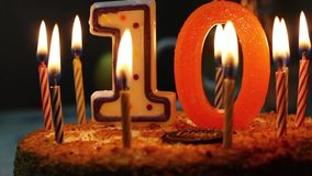 Burning candles on the cake. Ten years. Birthday