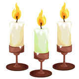 Burning candles in the candleholders. Vector Royalty Free Stock Photo