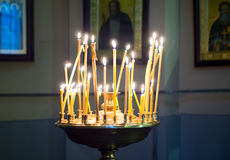 Burning candles on a candlestick, `the health` in front of icons in the Orthodox Church Stock Photo