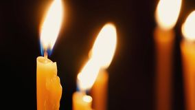 Burning candles. Celebration event or religious memorial attribute of warmth and sincerity stock footage