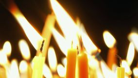 Burning candles. Celebration event or religious memorial attribute of warmth and sincerity stock video footage