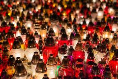 Burning candles at a cemetery during All Saints Day Stock Photos