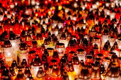 Burning candles at a cemetery during All Saints Day Royalty Free Stock Photo